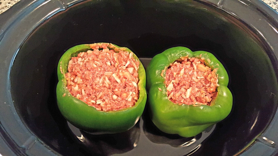 Slow Cooker Stuffed Peppers spoon mixture into peppers and add to crockpot