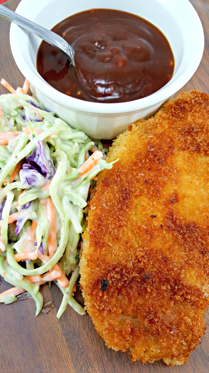 Tonkatsu and Homemade Tonkatsu Sauce - This dish is super easy to make, delicious and satisfying. Tonkatsu is a Japanese dish which consists of a pork cutlet coated in Panko (Japanese bread crumbs) fried, then topped with Tonkatsu sauce. This homemade sauce is tangy and delicious. It is often served with shredded cabbage but we like it much better with broccoli slaw or coleslaw. You can also use chicken instead of pork using this same recipe.