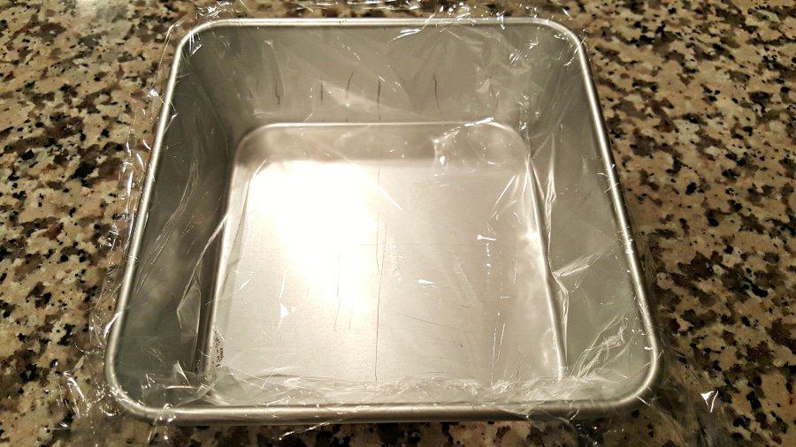 Frozen Raspberry Chocolate Cake - small batch line pan with plastic wrap