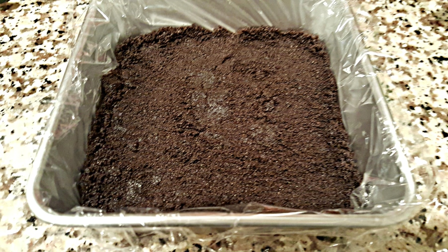 Frozen Raspberry Chocolate Cake - small batch press Oreo crust into pan