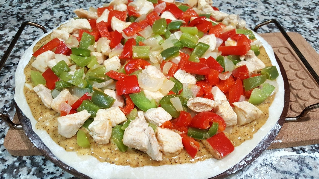 Chicken Fajita Pizza Recipe- layer cooked green peppers, red peppers, onions, and chicken mixture over the sauce