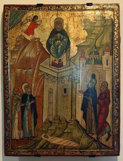 Simón el Estilita subido en una delgada torre siendo observado por gente no dejaba que las mujeres se arrimaran a un a su madre