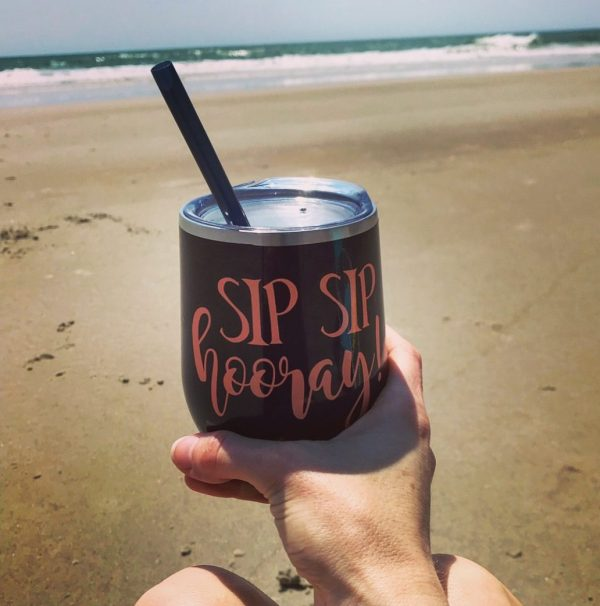 sip sip hooray navy with coral glitter on beach