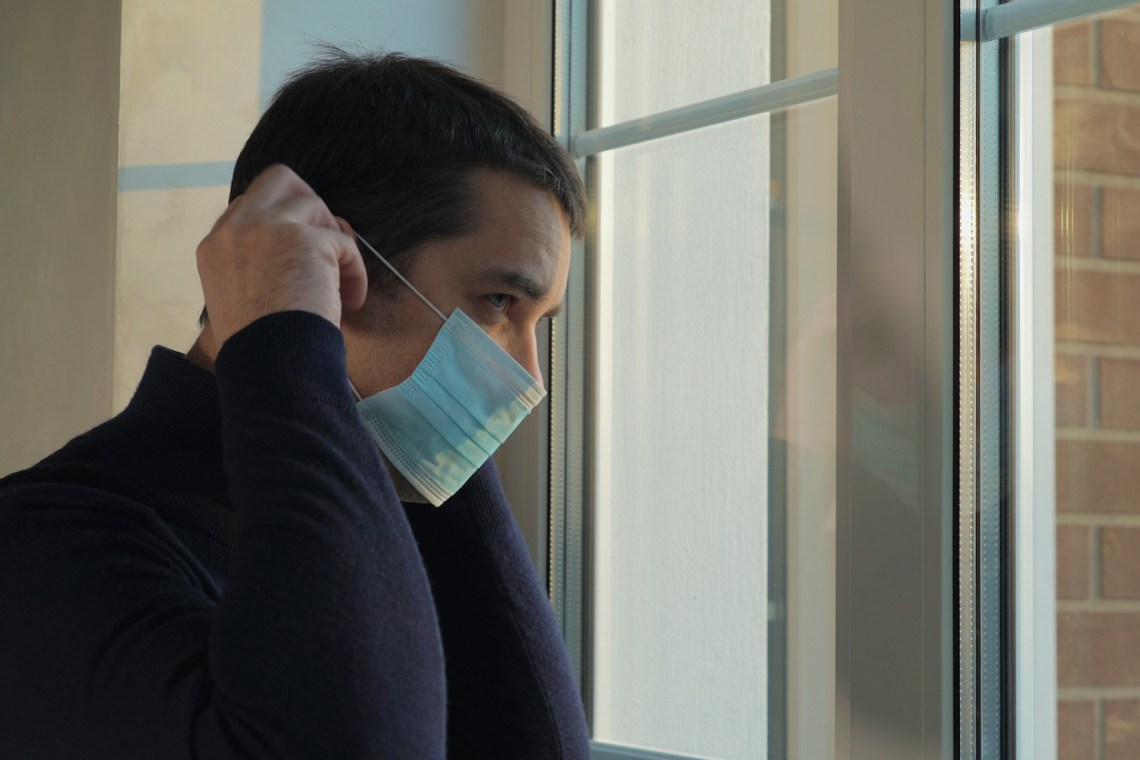 Man goes for a walk in a medical mask