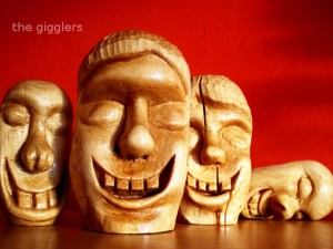Gigglers, wood carving