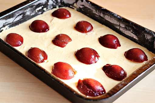 plum cake recipe with step by step picture tutorial, evenly arrange the halved plums on top of the batter
