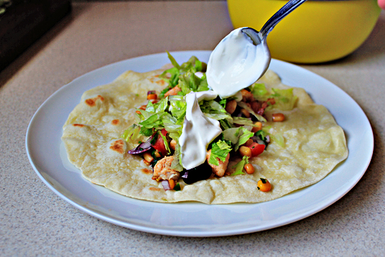 chicken burritos recipe with step by step picture instructions, prepare the tortillas according to instructions and fill them first with the vegetable mixture, then the chicken, with a little bit of lettuce, and finally with 1 tablespoon sour cream
