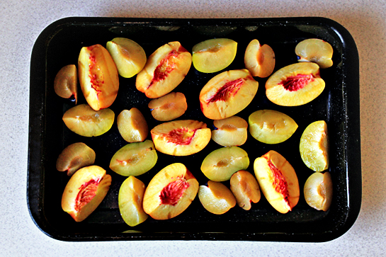 roasted summer fruit with rosemary and cream recipe with step by step pictures, scatter all your fruit in a roasting pan