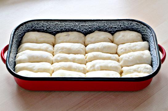 sweet jam filled buns in a baking pan