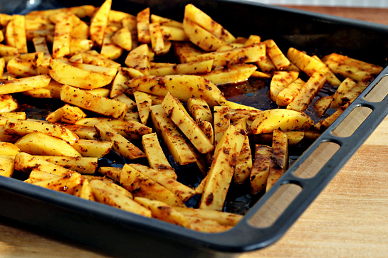 man approved spicy oven baked french fries spray or brush a baking sheet with vegetable oil generously Then place the wedges on the baking sheet