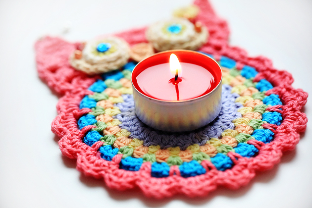 crochet owl coaster and red candle