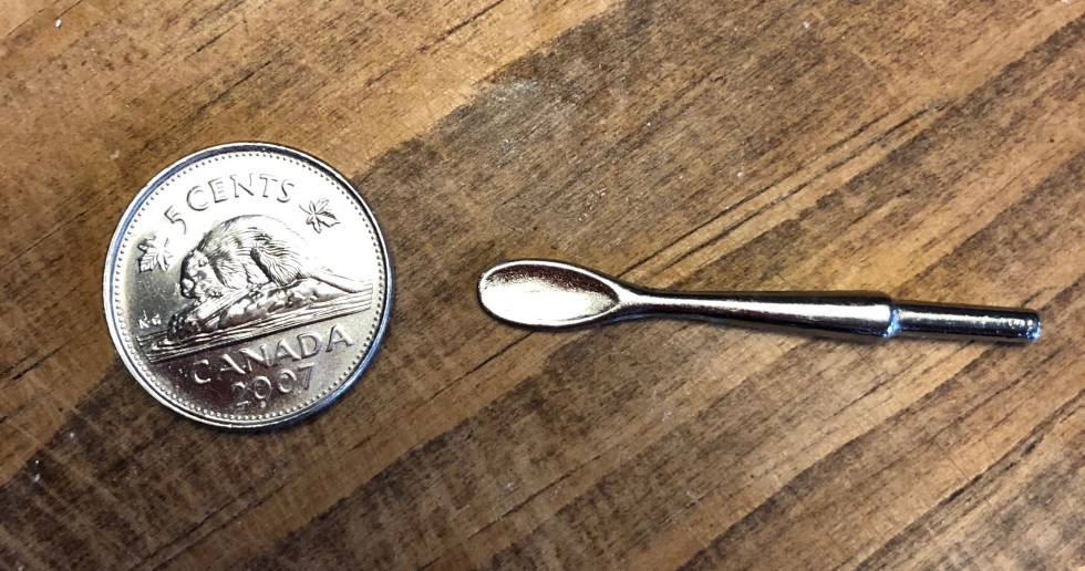miniature spoon and nickel