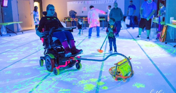 Art Star adding his design to the painting, using the Zot Art Wheelchair painting tool