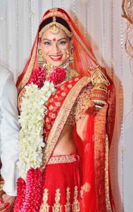Bipasha Basu in a red Sabyasachi lehenga on her wedding