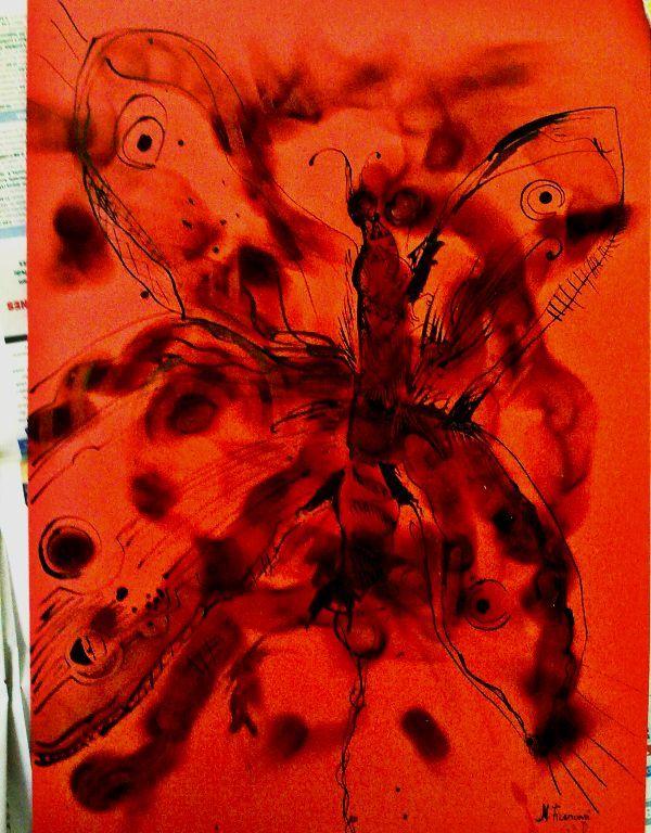 Malba vytvořená pálením svíčky u výkresu - velká můra na červeném papíře.
