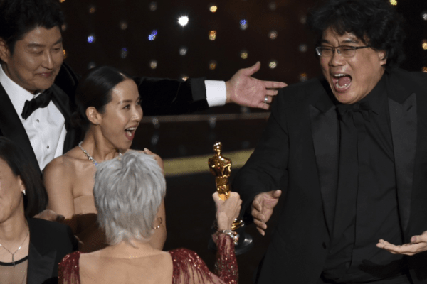 Bong Joon-ho reacts as he is presented with the Oscar for best picture for Parasite by actress Jane Fonda at the Academy Awards ceremony at the Dolby Theatre in Los Angeles. Looking on from left is the film's star Song Kang-ho. Photo: AP