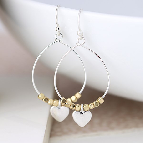 Silver teardrop earrings with gold beads and heart