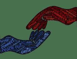 zwei gezeichnete Hände die in Verbindung treten