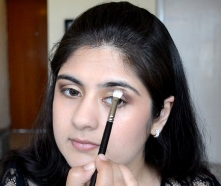 How to apply makeup - Chic bronze and purple eye makeup 12