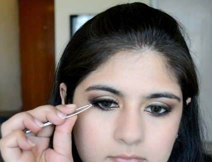 How to apply makeup - Chic bronze and purple eye makeup 18