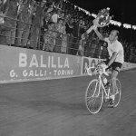 Italian Fiorenzo Magni is cheered on around Milan's Viggorelli Velodrome after winning the 38th Giro 1955.