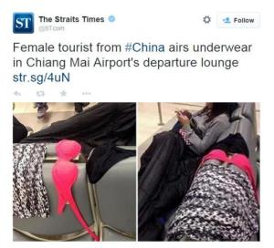A Chinese tourist dries her wet underwear at the Chiang Mai Airport