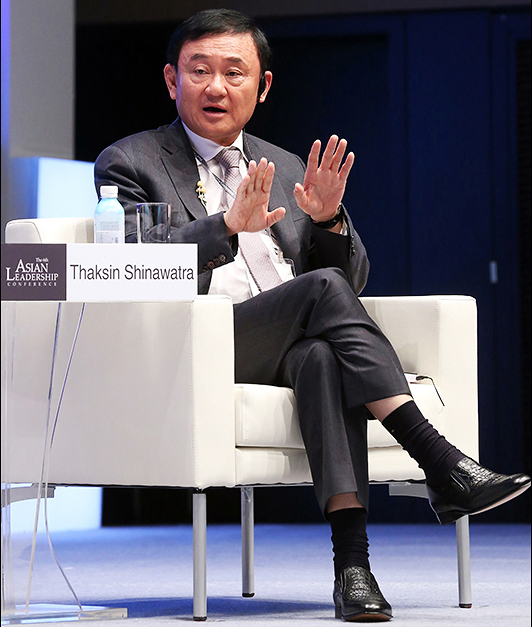 Thaksin Shinawatra speaking at the Asian Leadership Conference in Seoul, South Korea.