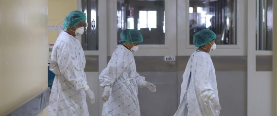 Thai hospital staff work in the isolation ward where a 75-year-old man from Oman was being treated for the Middle East Respiratory Syndrome (Mers) at Bamrasnaradura Infectious Diseases Institute in Nonthaburi province on June 19, 2015