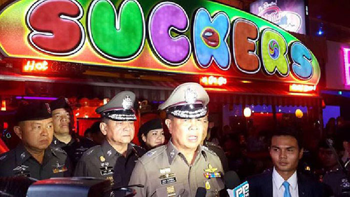 "Outgoing national police chief Gen. Somyot Pumpanmuang, speaks to reporters in front of a popular go-go bar ""Suckers"" in Nana Plaza, located on Soi Sukhumvit 4."