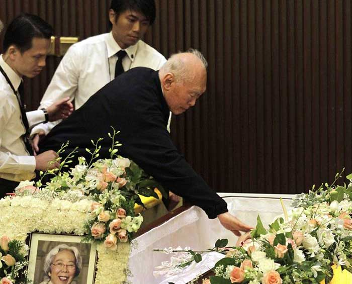 Lee Kuan Yew giving his wife two final kisses as she laid in her casket at the Mandai Crematorium in Singapore on Oct. 6, 2010. Kwa Geok Choo, 89, died on Oct. 2