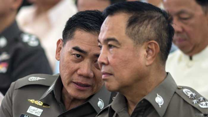 The next Thai national police chief Chakthip Chaijinda (net worth 1 Billion Baht) talks with Thai national police chief Somyot Pumpanmuang (net worth 350 Million Baht) during a religious ceremony near the Erawan shrine