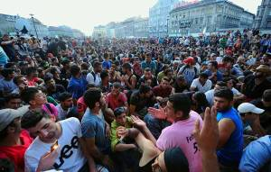 Hundreds-of-desperate-migrants-poured-into-Budapest's-main-railway-station-this-morning-after-Hungarian-police-withdrew-following-a-two-day-standoff,-triggering-chaotic-scenes-