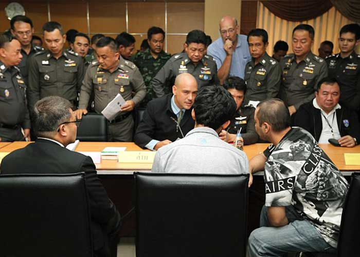 Yusufu-Mierili-listens-to-a-Turkish-language-interpreter-as-he-is-publicly-questioned-by-police-at-Bangkok's-Metropolitan-Police-Station1
