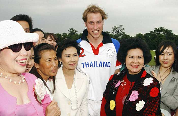 Prince-William,-wearing-a-Team-Thailand-kit,-poses-for-a-photograph-with-fans-at-the-Chakravarty-Cup-in-June-2005,-in-Richmond