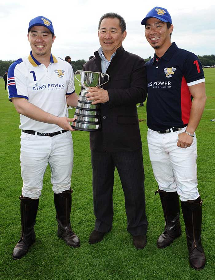 Vichai-(centre)-celebrates-with-King-Power-polo-players,-including-his-son-Top-after-the-victory