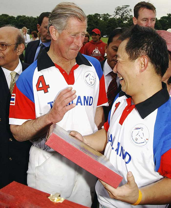 Vichai,-who-has-connections-with-the-royal-families-in-both-Thailand-and-Britain,-shares-a-joke-with-Prince-Charles-at-the-Chakravarty-Cup-Polo-match