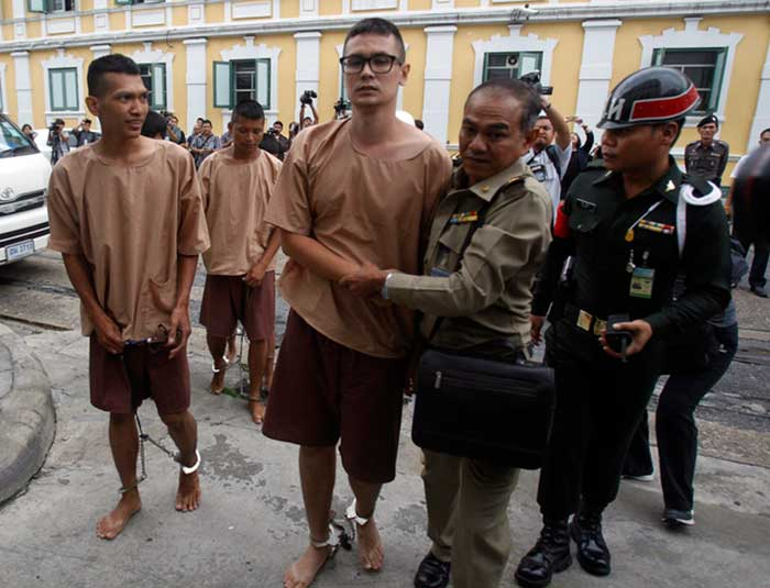 Student activist Rangsiman Rome, center, and other members of the New Democracy Movement(NDM) group arrive at the military court in Bangkok, Thailand, Tuesday, July 5, 2016. Human rights groups expressed their concerns that the students were arrested for exercising their rights to freedom of expression ahead of the Aug. 7, 2016, referendum on the draft constitution.