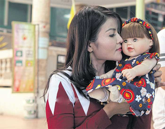 danita-phosachai-has-four-children-but-considers-her-doll-part-of-the-family