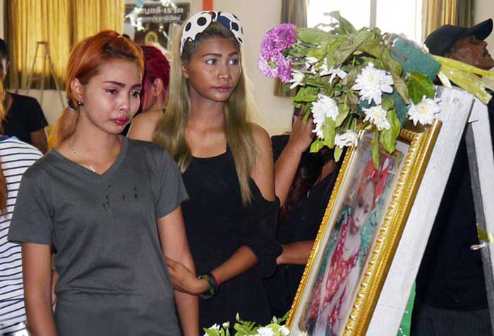Chiranut Trairat, mother of an 11-month-old baby girl, cries in front of her daughter's portrait before her funeral in Phuket, Thailand, Saturday, April 29, 2017.