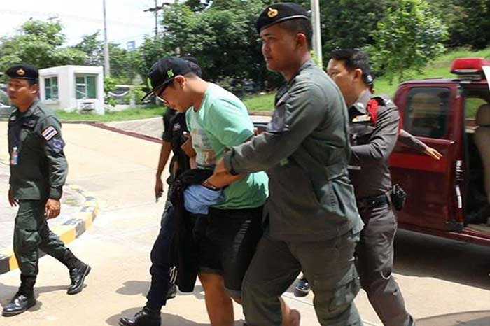 Wasin-Namprom,-25,-one-of-five-suspects-in-the-grisly-murder-of-a-22-year-old-karaoke-bar-worker,-is-taken-to-the-Khon-Kaen-provincial-court-for-detention