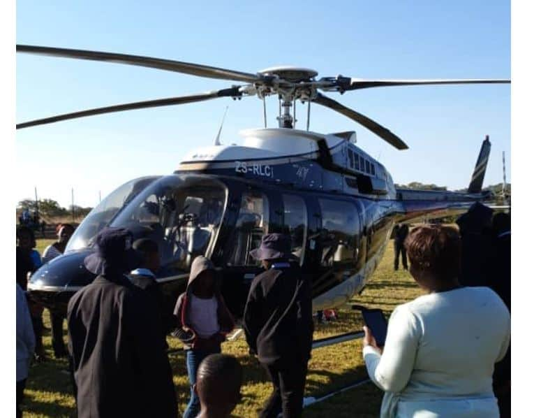 Masvingo tycoon visits children' school in chatered helicopter..PICTURES