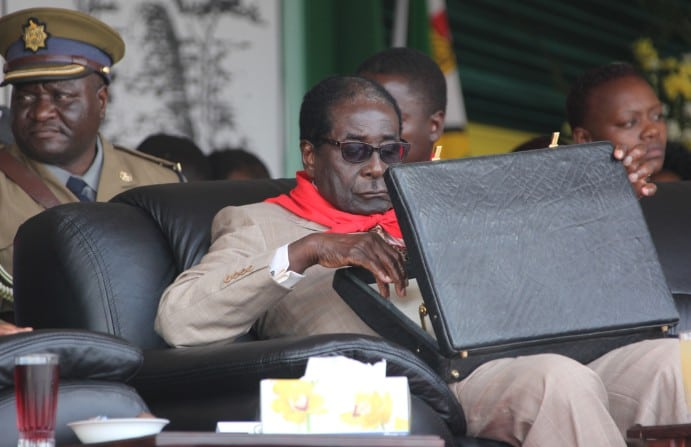 """Mugabe used to travel with a bag of cash..he feared a coup"""
