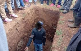 Man forced to exhume wife's body