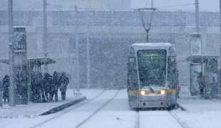 21/12/2010 A Luas drives through snow & ice conditions at the Red Cow Luas Station , Dublin. Photo: Gareth Chaney Collins