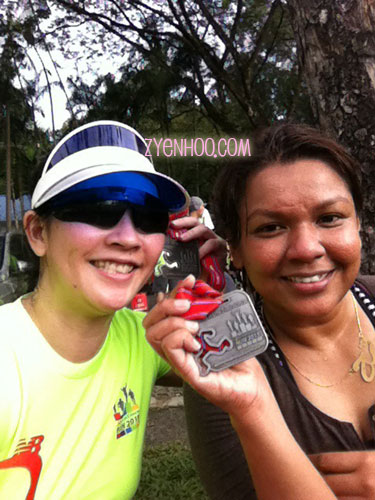 Farah and me after the run with our medals