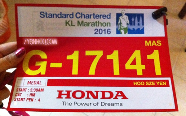 My bib for the half-marathon! But they forgot to punch a hole in the top left corner.