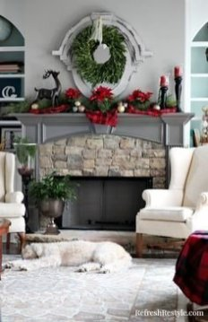 Gorgoeus Rustic Stone Fireplace With Christmas Décor 19