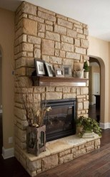 Gorgoeus Rustic Stone Fireplace With Christmas Décor 24