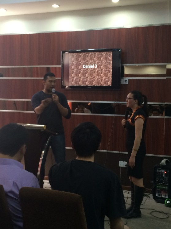 JayArr preaches at the City Harvest Church, with Murun doing the translations.