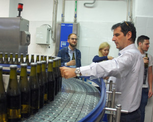 Menabrea brewery managing director Franco Thedy pulls a bottle out of the line